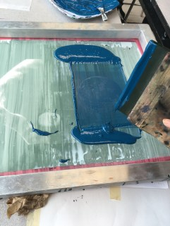 The ink is dragged across the screen twice using the squeegee.