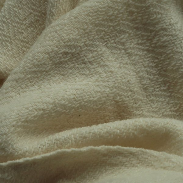 This naturally beautiful scarf has been woven on a handloom and left in its own natural creamy colour without being treated with any dying.Ethically made in india andcertified by Craftmark as hand woven and hand-dyed.Made with a blend of super fine wool & merino wool yarns.