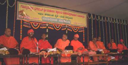 Left to Right - Sri Lakshmisena Bhattarakha Swamiji, Melchitamur; Sri Dhavalakeerthi Bhattarakha Swamiji, Tirumalai; Sri Bhanukeerthi Bhattarakha Swamiji, Kambadahalli; Sri Lakshmisena Bhattarakha Swamiji, Narasimharajapura; Sri Charukeerthi Bhattarakha Swamiji, Shravanabelagola; Sri Bhattakalanka Bhattarakha Swamiji, Sonda; Sri Lalithakeerthi Swamiji, Karkala; Sri Vrushabasena Bhattarakha Swamiji, Lakkavalli; and Sri Charukeerthi Bhattarakha Swamiji, Moodabidri.