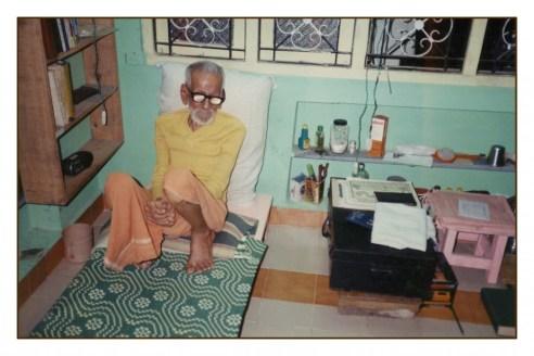 sar_sitting_on_bed_on_floor