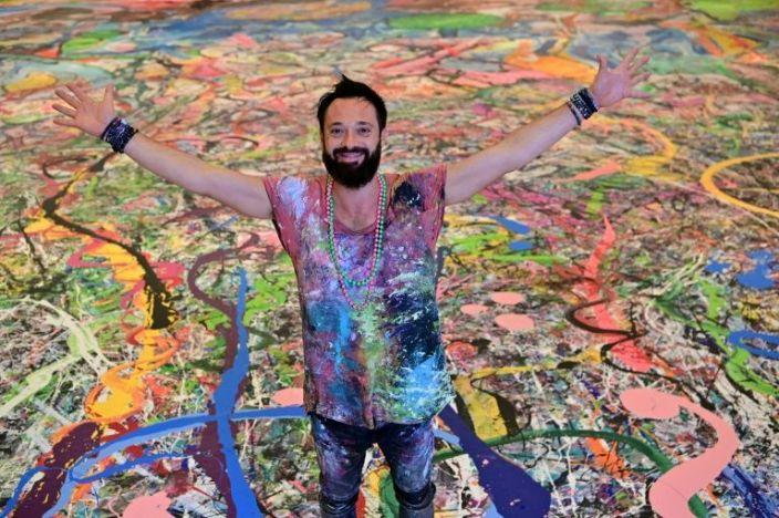 Jafri paints giant canvas for children of the world