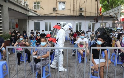 Vietnam reports record high of new Covid-19 cases