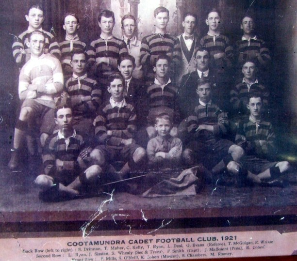 Cootamundra Cadets team of 1921 which included Eric Weissel; from left to right from back row: Sid Drinnan, T.Maher, C.Kelly, Tom Ryan, L.Deal, Glenn Evans (referee), T.McGuigan, Eric Weissel (aged 18), L.Ryan, J.Sissian, S.Whealy (secretary & treasurer), F.Smith (captain), J.Maffersoni (president), R.Cohen, P.Mills, S.O'Neill, K.Cohen (mascot), Sid Chambers, M.Rooney. Source: S.G. Chambers, Cootamundra.