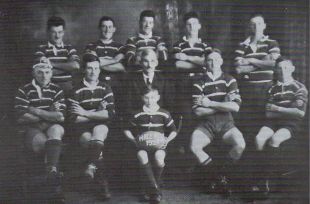 Back from Left: Bob, Ben, Walter, Roy, Tom - Front: Sid, Jim, Jim Hall senior, Abe, Dave and Clem with the ball