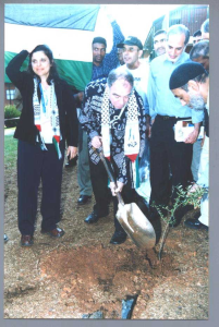 Roni Kasrel planting a tree for Lubya in Johansberg