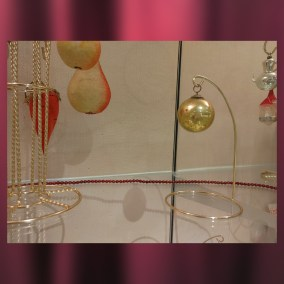 Glass balls like this were first made by German glassblowers in the town of Lauscha beginning in the 1820s. Known as Kugels, many of these balls were silvered with lead or zinc to give them a reflective, mirror effect. By the mid-19th Century, the bulbs became popular Christmas tree ornaments.   <br><br>Gift of Alice Resch Powers, 78.71.15