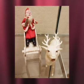 "Japanese composition ""clay face"" Santa Claus (1920s-30s) with sleigh and celluloid reindeer (1940s-50s)  <br><br>Gift of Alice Resch Powers, 78.71.77"