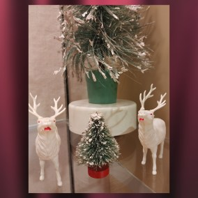 Japanese revolving bottlebrush tree, circa 1940s, and celluloid reindeer  <br><br>Gift of Alice Resch Powers, 78.71.79, .91