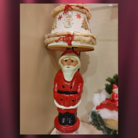 Santa Claus Papier-mâché lamp, made by the Unger Doll and Toy Company of Wisconsin, 1930s  <br><br>Gift of Beverly McKinley, 2011.101.07