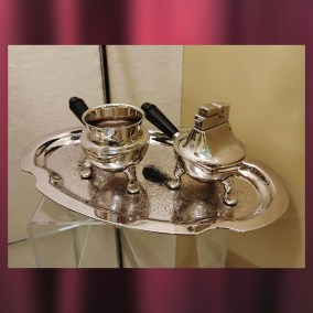 Smoking set, given to Charles Carl as a Christmas gift from his employer, Fredonia Seed Company, in the 1950s.  <br><br>Gift of Margaret F. Carl, 2001.10.29