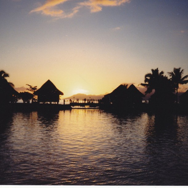 Sunset over the bungalows in Tahiti