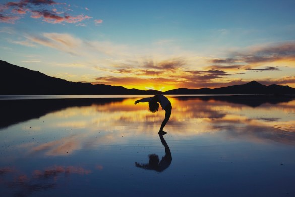 yoga on a stunning sunrise to symbolise intention setting