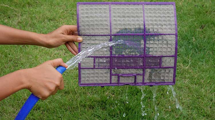 How to Clean an Air Conditioner Filter and rinse it with water