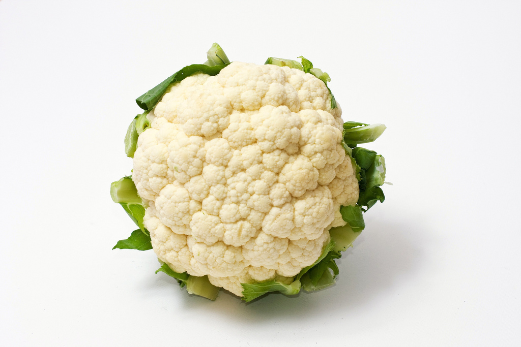 White cauliflower with green leaves