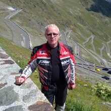 The Stelvio Pass (Italian: Passo dello Stelvio; German: Stilfser Joch), located in Italy, at 2757 m (9045 feet) is the highest paved mountain pass in the Eastern Alps, and the second highest in the Alps, slightly below the Col de l'Iseran (2770 m, 9088 feet).