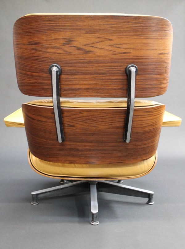 yellow eames lounge chair back view photo