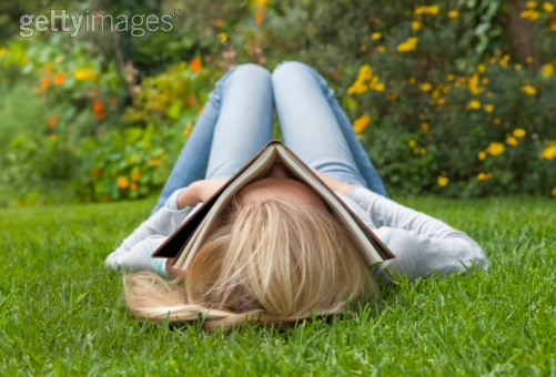 woman sleeping in the garden with a book