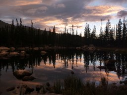 After spending too much time holed up in a leaky tent, I awoke to the awe-inspiring beauty of Rocky Mountain National Park at sunrise. This is Chipmunk Lake.
