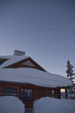 From the outhouse, looking back at the Ben Eiseman Hut. Sun is rising, moon is just chilling.