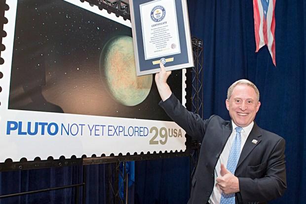 Pluto stamp record