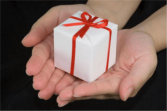 Wrapped gift in hands