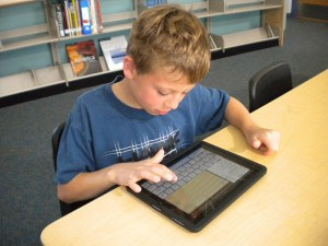 Student using iPad to read