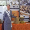 2011 American Honey Princess Allison Adams helps the WMBA ambassador beekeeping at the Fryeburg Fair.