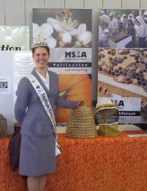 2011 American Honey Princess Allison Adams helps the WMBA ambassador beekeeping at the Fryeburg Fair.