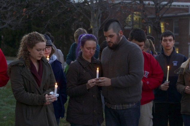 Co-President of French Club, Mitchel Roberge, right, stands with Grace Weise, middle, at a candlelight vigil to honor victims of terrorism, Tuesday, Nov. 17. Sophia Lataille, left, also co-president of French Club stands with them.