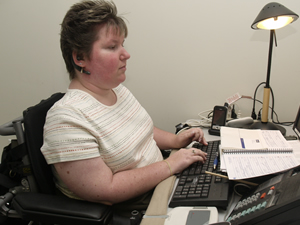 Person at desk using keyboard