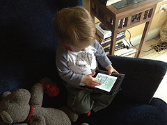 """From my tongue-in-cheek publicity campaign """"Cute Babies Read Clammed Up."""" This is the first photo that came in with an e-reader. The toddler is names Winter for her Maine born-and-bred mother's favorite season. Her mom reports that the way she uses and iPad is """"terrifying."""" I believe it."""