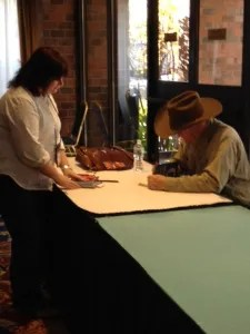 Craig Johnson signing a book for a fan
