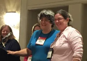 Mystery Writers of America Executive Vice President Donna Andrews presents me with a ribbon recognizing me as one of the 22 debut novelists at the 2015 New England Crime Bake.