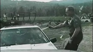 Franconia, New Hampshire, police officer Bruce McKay pepper sprays Liko Kenney in 2007 in this police cruiser video image released by the NH attorney general's office at the time. Moments later, Kenney shot McKay. The aftermath inspired a central plot piece in Cold Hard News.
