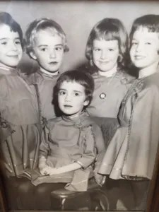 I suspect this photo was taken a year or two after the famous Irish-American Club party. I am seated. My sister SuEllen is the fair-haired girl second from left.