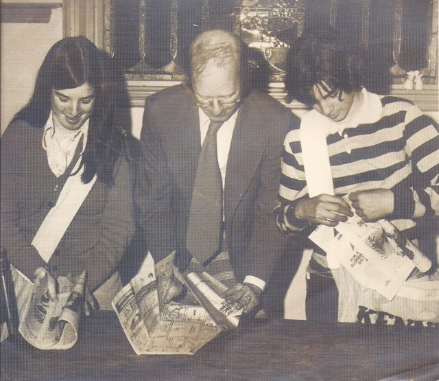 Me, my dad and my brother Jimmy show our paper-folding techniques in a Kennebec Journal promotion in October 1975. Dad was managing editor and I was on my second paper route at the company I know work for.