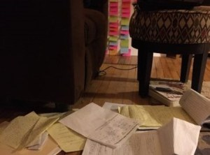 a bunch of papers and notes scattered across a floor