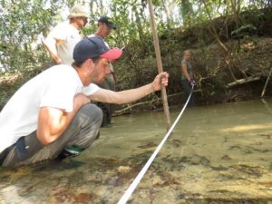 York students Gavin Fischer and Anna Schindler help develop a stream profile in the highland region of Taboco, Brazil.