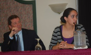 Commissioner Bowen listens as Monmouth Academy senior Adriana Ortiz-Burnham describes a typical day in her student-centered AP Biology class: one group of students listening to the teacher's lecture, one group working in the lab, and another taking a test.