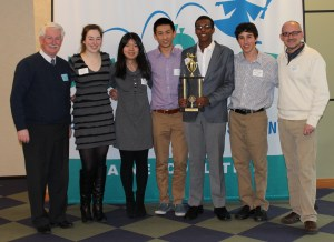 Waynflete School students accept trophy for winning the state competition for LifeSmarts, the ultimate consumer challenge.