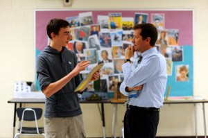 Eighth grader Malcolm Dunson-Todd explains the school's academic structure to Commissioner Bowen.