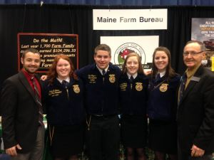 Maine FFA State Officers at Maine Farm Bureau Display Left to right:  Representative Anthony J. Edgecomb, Maine House District 148 (Fort Fairfield), Carly Grass, Maine FFA Vice President, Tyler Raymond, Maine FFA Reporter-Sentinel, Jordan Canney, Maine FFA Secretary-Treasurer, Whitnie Bradbury, Maine FFA President, Senator Peter Edgecomb, Maine Senate District 1 (Caribou).