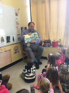 Commissioner Hasson reading to students at Acadia Academy