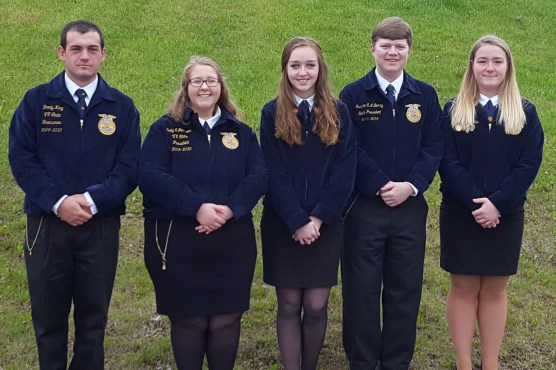 Vermont trainees (left two) and Maine trainees (right three) join each other in official FFA dress