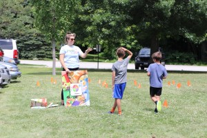 Representatives from Let's Go! 5-2-1-0 Goes to Child Care doing activities with kids