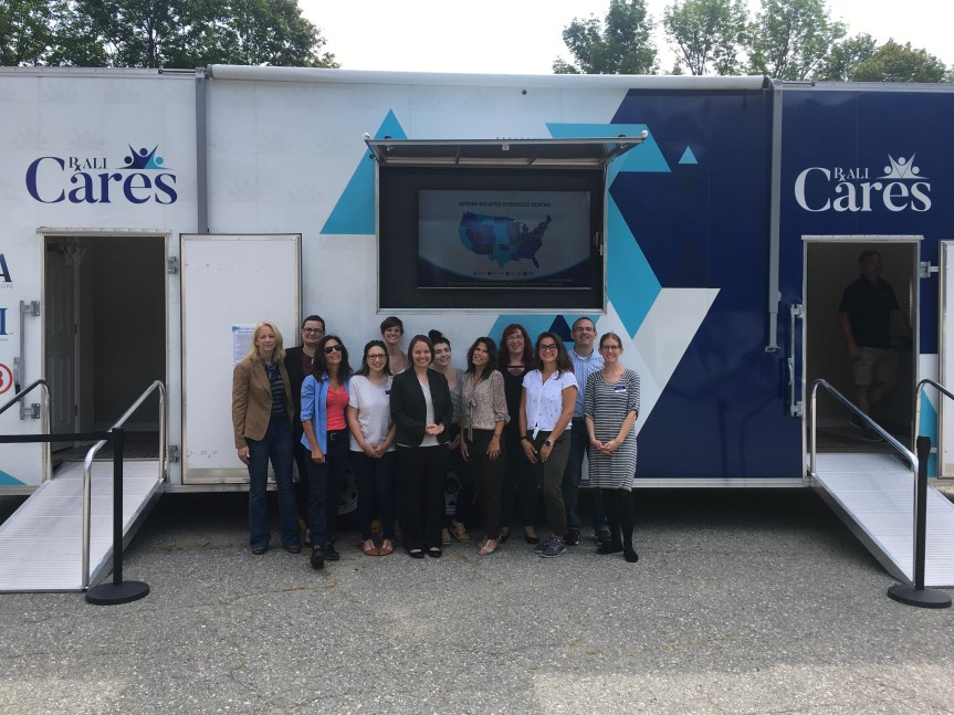 NAMI Maine employees pose with Senator Shenna Bellows, and RxALI Partnership Coordinators Lisa and Rosemary Baldacci in front of the Youth Bedroom Trailer.