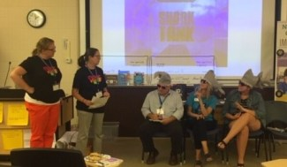 Educators presenting to other educators wearing shark hats