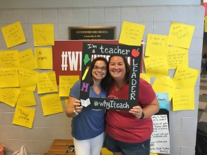 Teachers smiling holding sign #whyIteach