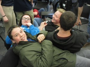"Practicing Teamwork through human ""table"" (table members left to right, facing camera): Wyatt Allen, Central Aroostook High School – Kristin Bragg & Haley Johnston, Washburn High School"