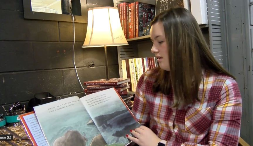student reading a book out loud